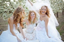Women wearing wedding dresses