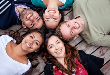 Group of people looking up and smiling
