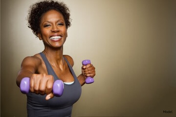 Woman holding weights while working out