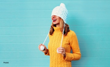 Girl pulling winter hat over her eyes