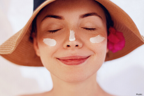 Woman with sunscreen on her face