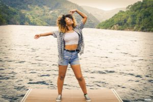 Woman dancing on a dock